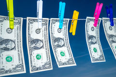 Hanging money with blue sky background. Drying dollar royalty free stock image