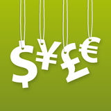 Hanging money signs on green background Stock Images