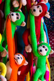 Hanging monkey doll. Hanging colorful long arm monkey doll Royalty Free Stock Photography