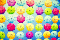 Hanging multicolored umbrellas over sky Stock Photos