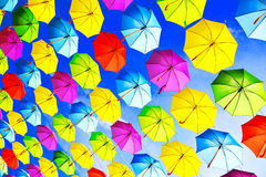 Hanging multicolored umbrellas over sky Stock Photography