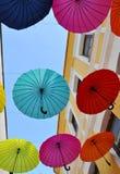 Hanging Multicoloured umbrellas over blue sky Stock Image