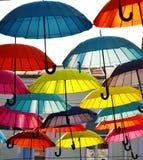 Hanging Multicoloured umbrellas over blue sky Stock Photos