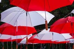 Hanging Multicoloured umbrellas over blue sky. Stock Image