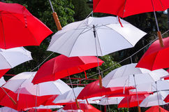 Hanging Multicoloured umbrellas over blue sky. Stock Photography