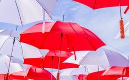 Hanging Multicoloured umbrellas over blue sky. Stock Photo