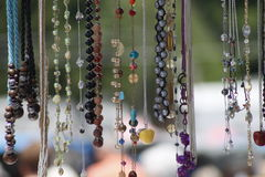 Hanging necklaces. For sale at a farmers market Royalty Free Stock Photography