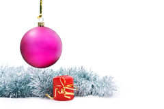Hanging New Year's toy and candle. Isolated hanging New Year's toy and candle on a white background Royalty Free Stock Photography