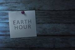 Hanging Note Paper With Earth Hour Message On Wooden Wall Stock Image