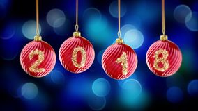 Hanging 2018 number glitter Christmas balls on blue bokeh background. Stock Photography