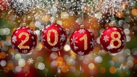 Hanging 2018 number glitter Christmas balls on gold bokeh background. 4K stock video footage