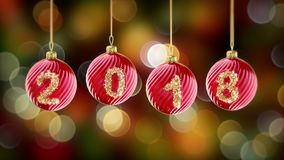 Hanging 2018 number glitter Christmas balls on gold bokeh background. Royalty Free Stock Photography