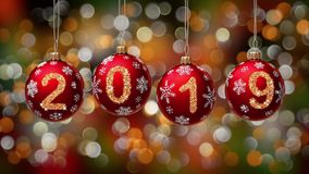 Hanging 2019 number glitter Christmas balls on gold bokeh background. 4K stock video footage