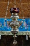Orthodox church. Silver hanging oil lamp - Bujoreni Monastery, landmark attraction in Romania Stock Photo