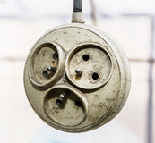 Hanging old dirty multiple electrical outlet Royalty Free Stock Images