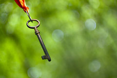 Hanging old key Royalty Free Stock Photography
