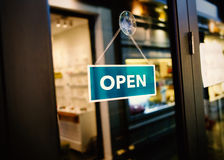 Hanging open sign in the shop Stock Photo