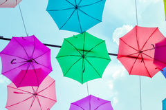 Hanging opened colorful umbrellas Royalty Free Stock Photo