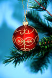 Hanging Ornament 2. Beaded Christmas ornament hanging from tree branch Royalty Free Stock Photography