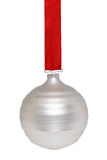 Hanging ornament. Silvery white Christmas ornament hanging from a red ribbon on white Stock Image