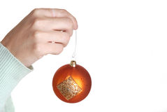 Hanging ornament II. Womans hand hanging an ornament Royalty Free Stock Photos