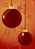 Hanging Ornaments. Hanging Christmas ornaments in front of a background with stars and scrolls Royalty Free Stock Images