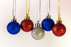 Hanging Ornaments. Blue, red and silver hanging ornaments isolated on white background Stock Photography