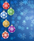 Hanging Ornaments on Blurred Snowflakes Background Stock Images