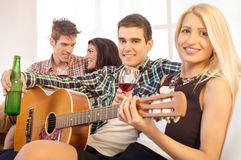 Hanging Out With Acoustic Guitar Stock Image
