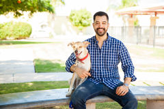 Hanging out with my dog. Portrait of an attractive young Latin man relaxing and spending some time outdoors with his dog Royalty Free Stock Photo