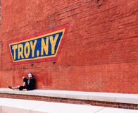 Hanging out under the new sign of Troy NY Stock Photo
