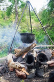 Hanging over the fire pot on a tripod tourist Royalty Free Stock Photography