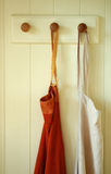 Hanging pair of Aprons Stock Photos