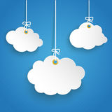 3 Hanging Paper Cloud Striped Blue Sky. Paper cloud on the blue background Stock Image