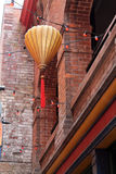 Hanging Paper Lantern and a String of Red Lights in Chinatown Royalty Free Stock Image