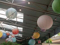Hanging paper lanterns at a festive, industrial warehouse setting stock photos