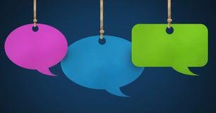 Hanging paper speech bubbles. Digital composite of Hanging paper speech bubbles Royalty Free Stock Images