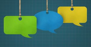 Hanging paper speech bubbles and grid background. Digital composite of Hanging paper speech bubbles and grid background Stock Photos