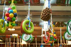 Hanging pastic toys an chestnuts royalty free stock photos