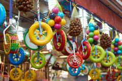 Hanging pastic toys an chestnuts stock photography