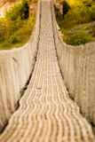 Hanging pedestrian bridge in Nepal Royalty Free Stock Photography
