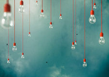 Hanging. Photo of Hanging light bulbs with depth of field. Modern art Stock Photography