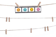 Hanging Photographic Negatives with smiley face,  Comedy happy l Royalty Free Stock Images