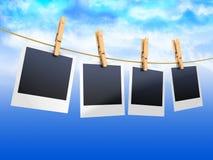 Hanging photos Stock Images