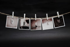 The hanging photos Stock Image