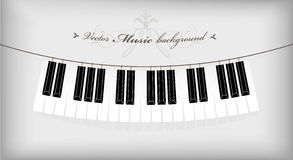 Hanging piano keyboard. With place for your text Royalty Free Stock Photo