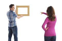 Hanging a picture. Royalty Free Stock Photo