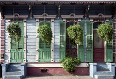 Hanging plants in front of house in New Orleans stock photo