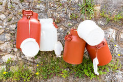 Hanging plastic white and brown milk cans Royalty Free Stock Photo
