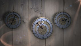 Hanging pocket watches ticking against wood stock footage